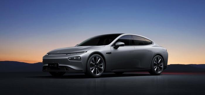 A silver XPeng P7, a sleek electric sedan