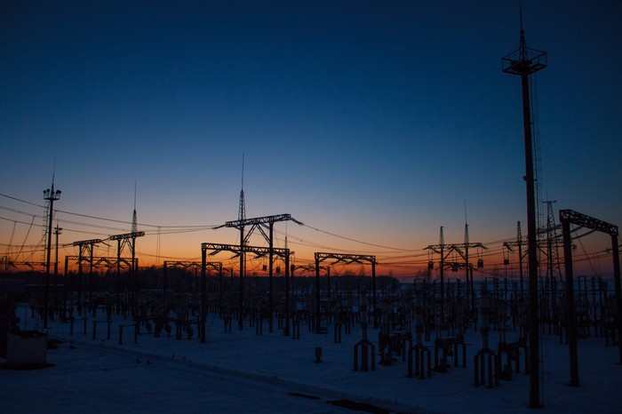 An electrical substation at dawn or dusk.