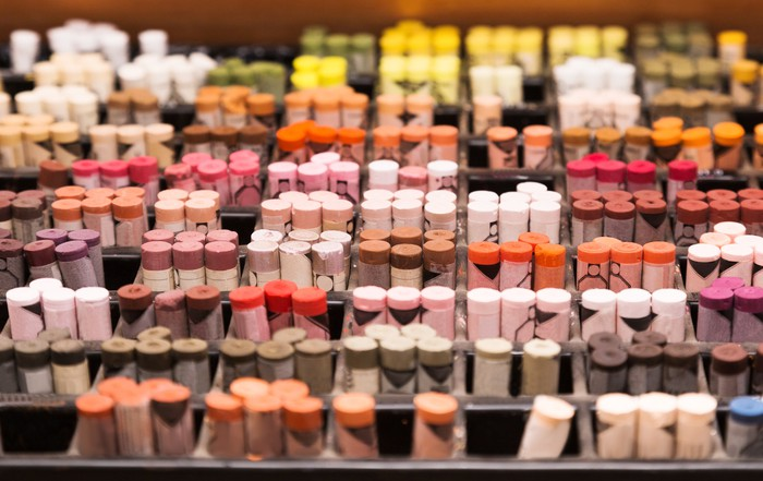 A display shelf showing several different colors of spools of thread
