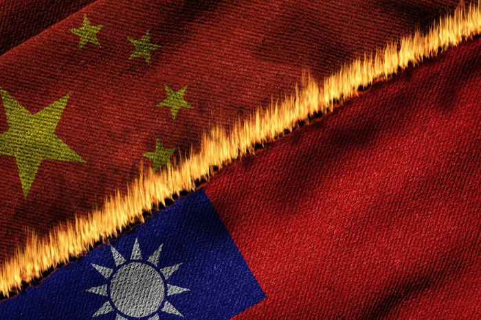 The Chinese and Taiwanese flags separated by a wall of flame.