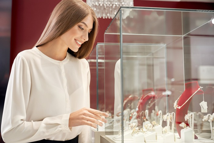 A young woman shopping for jewelry.