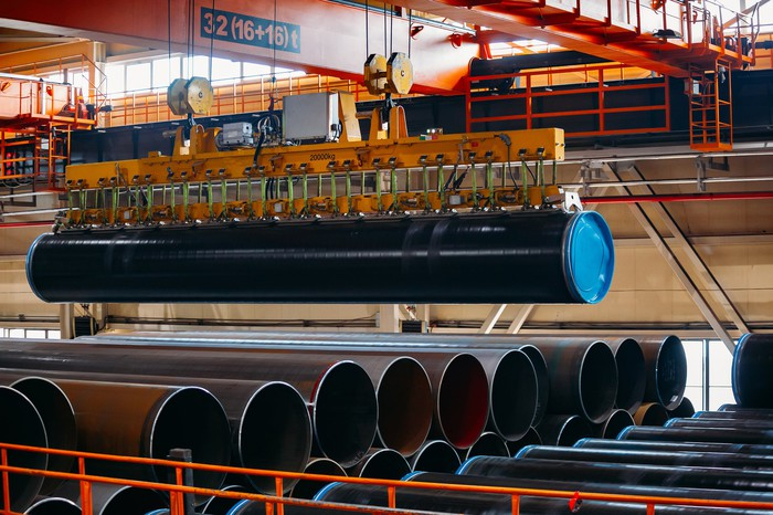 steel pipe used for energy being stacked in warehouse