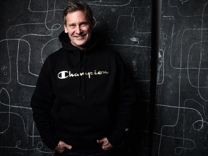 A man wearing a Champion sweatshirt.