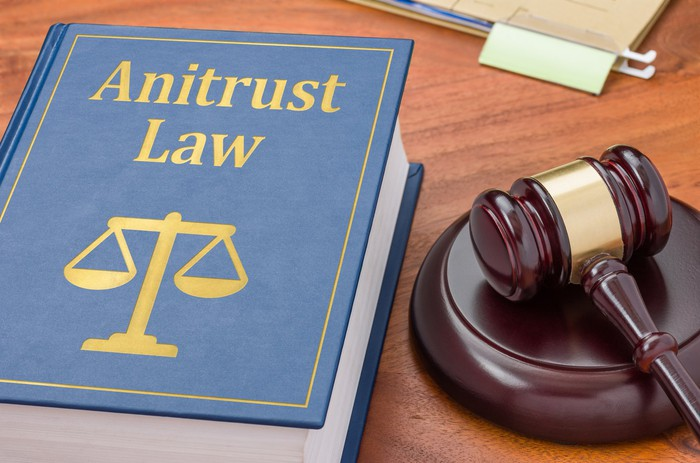 A book on a desk that says Antitrust Law on the cover next to a judge's gavel.