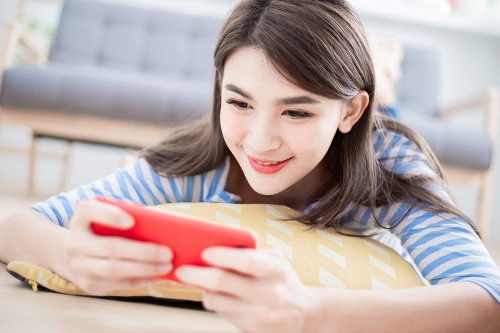 Young girl playing a game on her smartphone