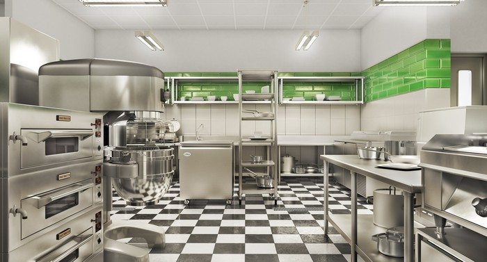 Stainless steel commercial kitchen with a black and white tile floor