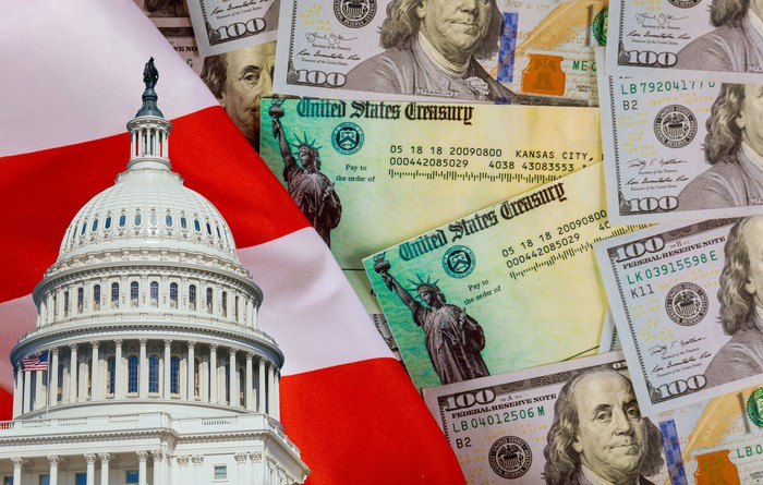 Capitol dome image over American flag with treasury bonds and hundred dollar bills.