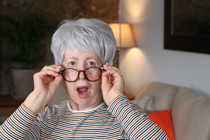 An older person wears a surprised expression.