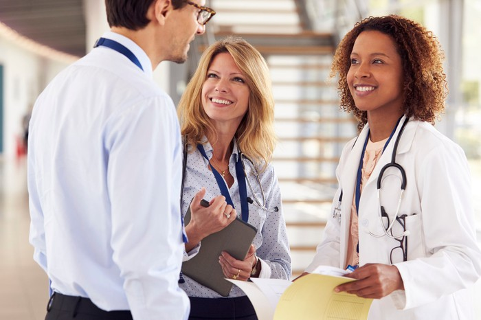 Physician speaking with sales rep.