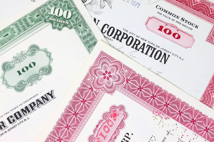 Several different stock certificates.