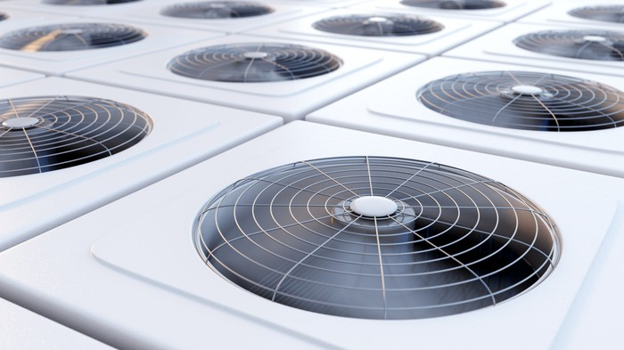 Group of HVAC units with fans.