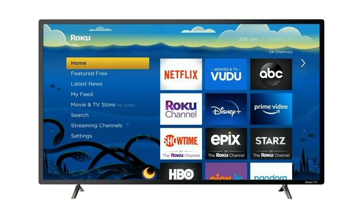 A Roku television displays the platform's menu.