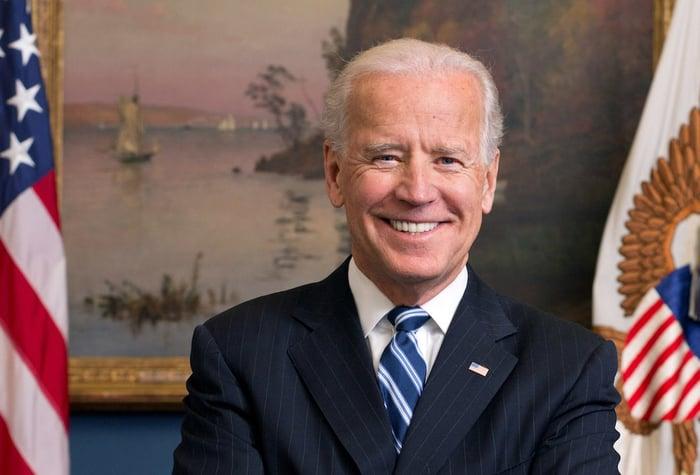 Joe Biden posing for a portrait in the White House.