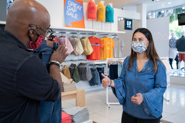 Gap employees wearing masks in a store.