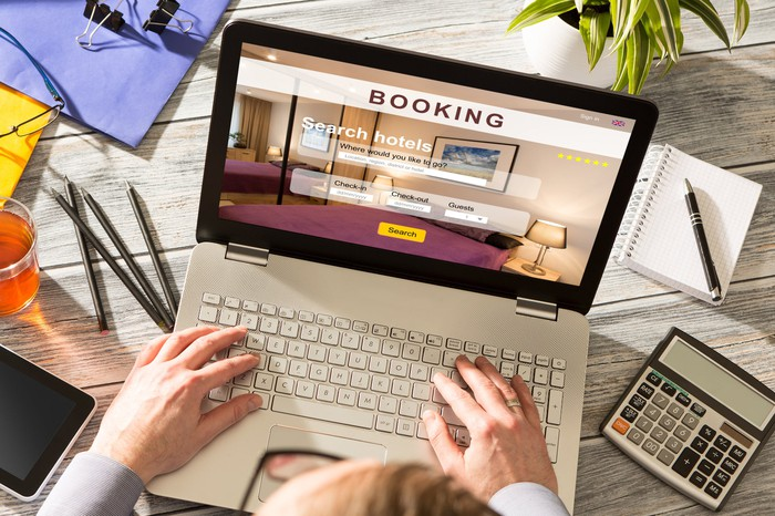 Person using a laptop to searching a travel-booking site