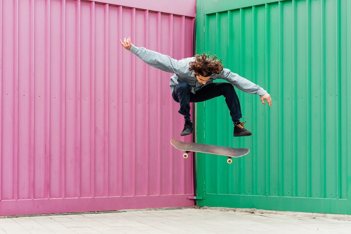 Young man performing moves on a skateboard.