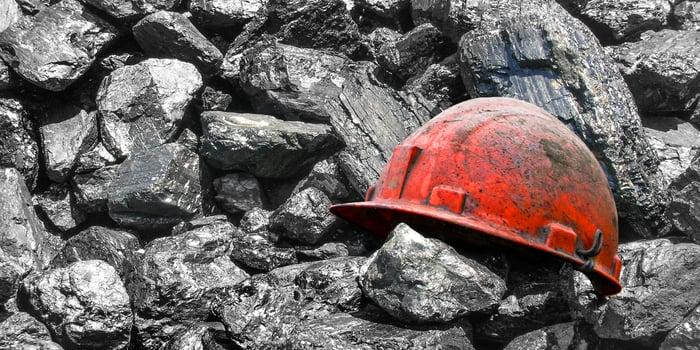 A hard hat among lumps of coal.