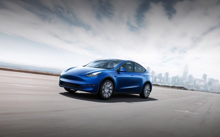 A Tesla vehicle outside of a city landscape.