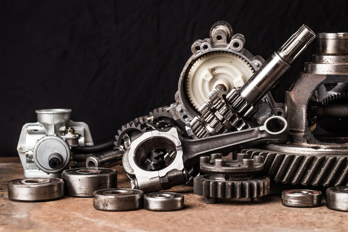 A collection of different car parts on a counter