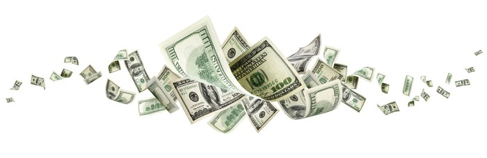 U.S. currency bills flying around in a swirl.