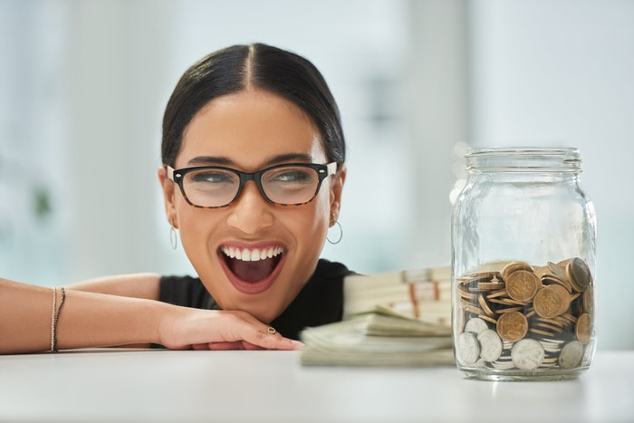 An investor excitedly looks at her savings.