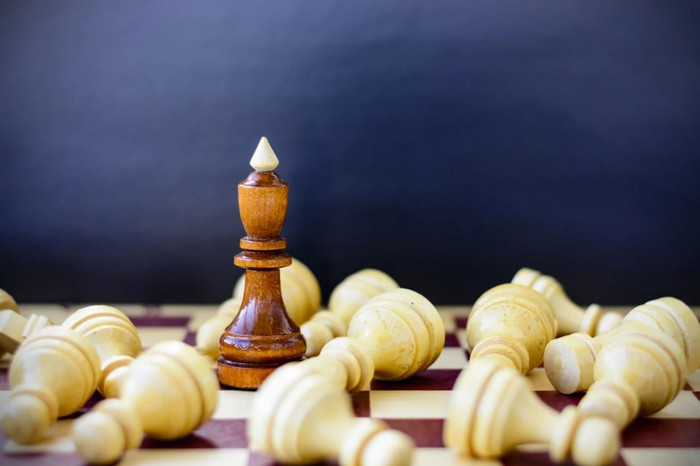 A bishop standing amid pawns lying on their sides.