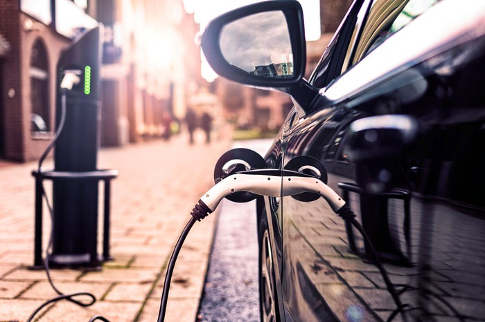electric car charging on city street