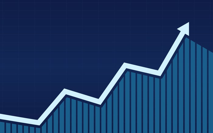 A white line graph on top of a blue bar chart.