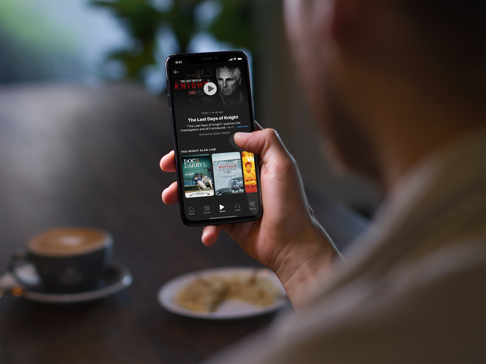 A person using the ESPN+ app on a smartphone.