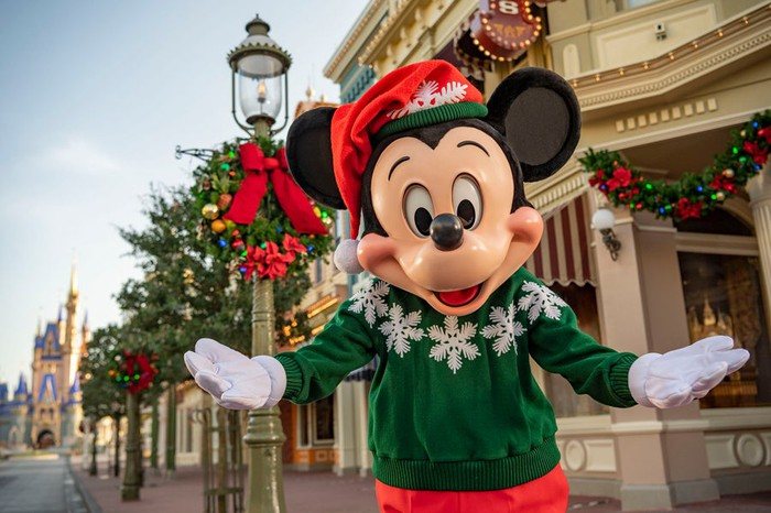 Mickey Mouse decked out in holiday attire on Main Street U.S.A.