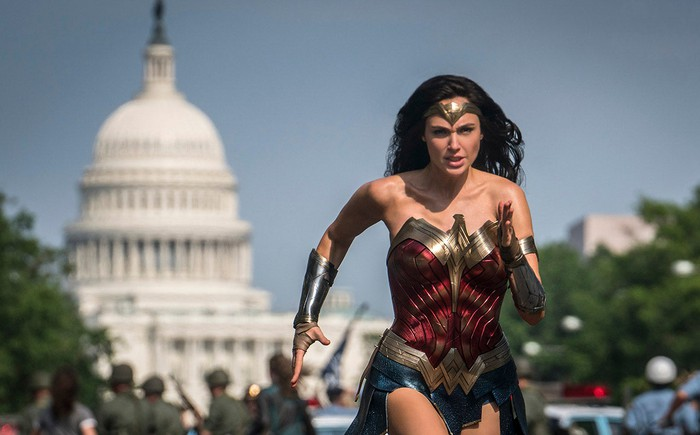 Wonder Woman running in front of the Capitol Building