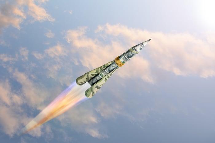Rocketship made of bills