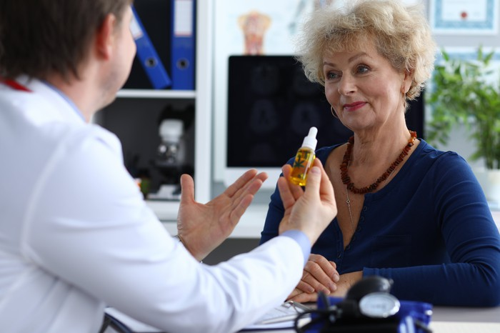 Doctor recommending CBD oil to patient.