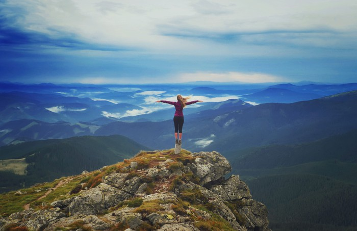 Young woman on a mountaintop.