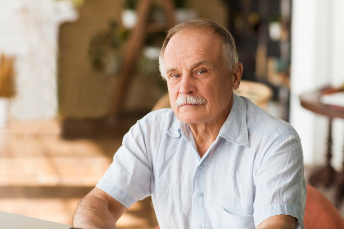 Older man with serious expression