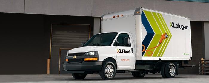 GM box truck with XL Fleet plug hybrid electric drive logo
