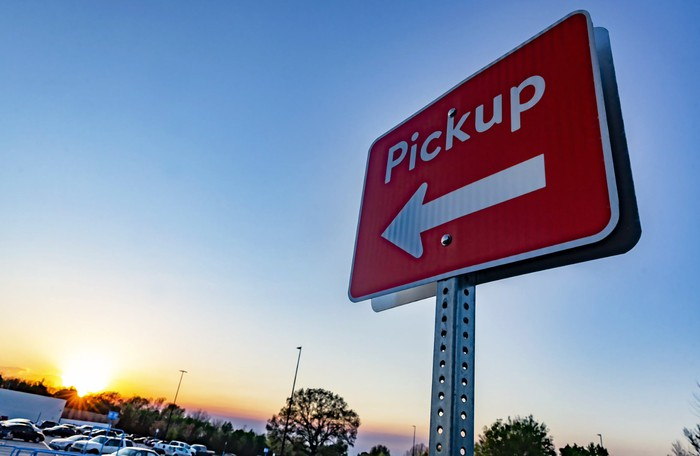An outdoor pickup sign at a Walmart store.