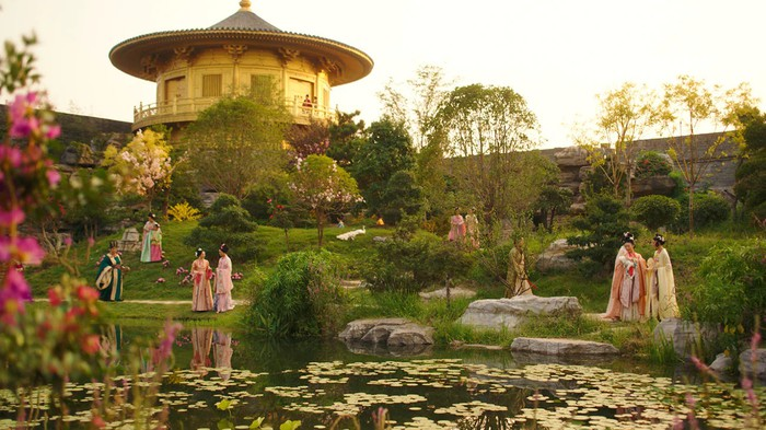 A scene from Disney's Mulan, showing geishas in a colorful garden.