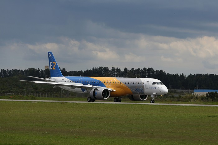 An Embraer E2 on the runway.