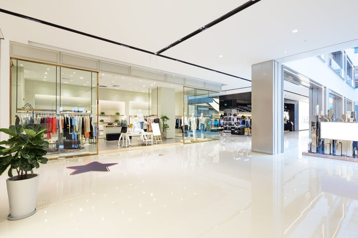 Corridor of an empty shopping mall.