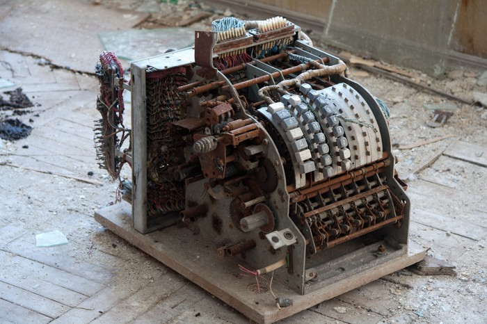 A broken, rusty cash register