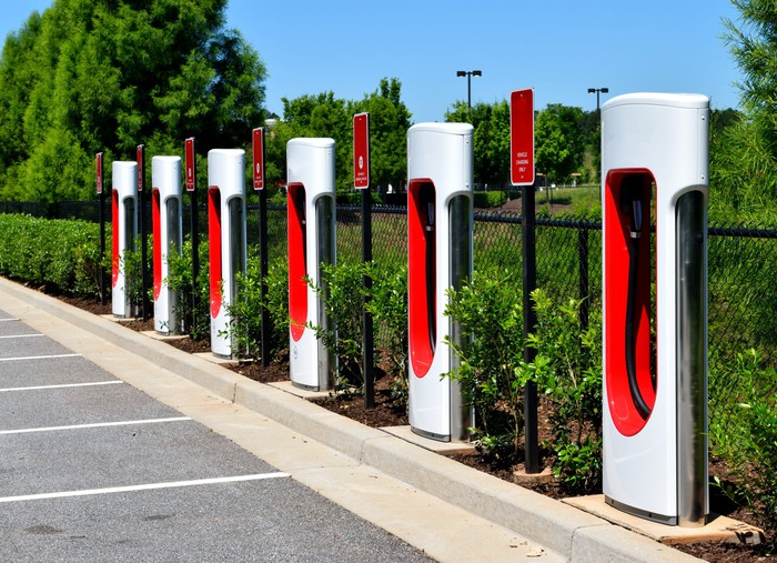 row of EV charging stations in front of parking spaces