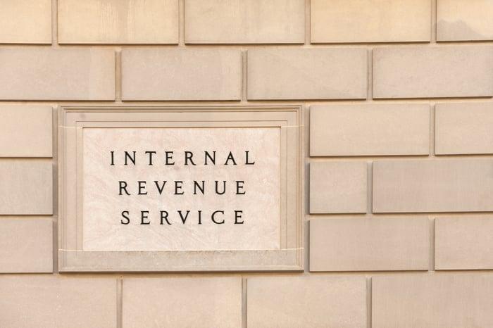 Plaque on brick wall reading Internal Revenue Service