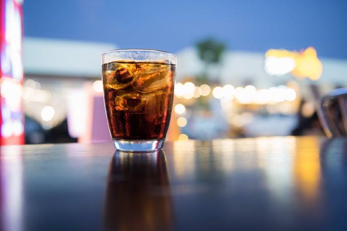 A glass of coke in a bar.