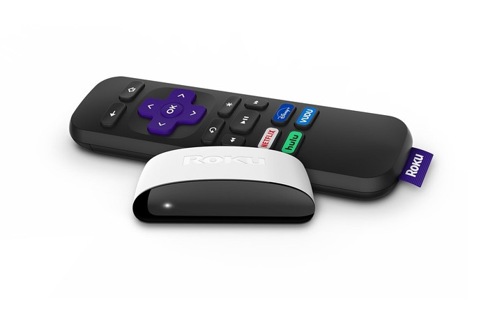 A Roku SE streaming device with its remote control.