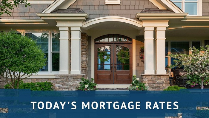 Up-close view of a well-kept suburban home with Today's Mortgage Rates graphic.