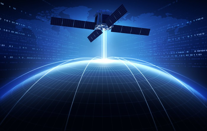 Satellite beaming down a signal to Earth