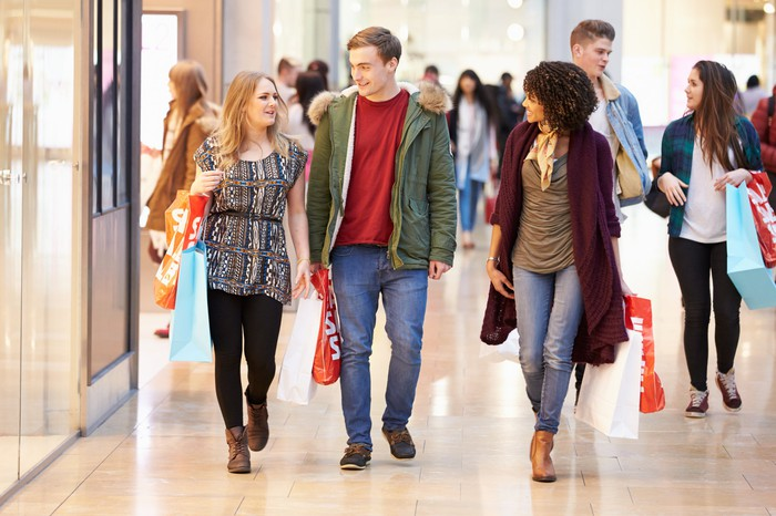 People walking in a busy enclosed mall.