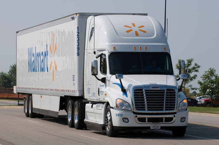 A Walmart truck rolling down the highway.