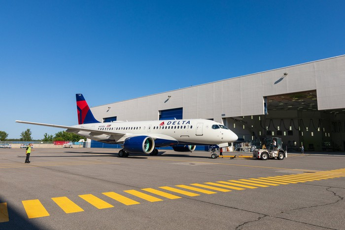 Delta's first Airbus A220 rolls out of a paint shop.